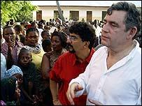Gordon Brown meets villagers near Tanzanian capital Dar es-Salaam