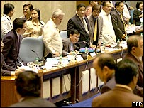 Congressional allies of President Gloria Arroyo stand up to register their vote 23 August 2005