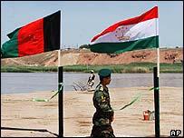 A Tajik guard patrols the border with Afghanistan