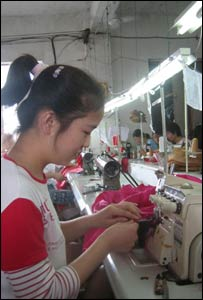 A worker at Hongwha Clothing in Shanghai