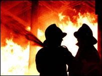 Firemen tackling blaze, BBC