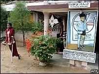 A mine victim leaves a prosthesis workshop in Kilinochchi