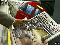 Commuter holds a copy of the Daily Mail with the headline: How did they get it so wrong?