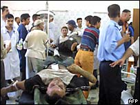 Injured people wait to be treated in Baquba