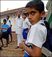 Unidentified students return to school in Galle