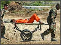 A detainee from Afghanistan is carried on a stretcher at Camp X-Ray, Guantanamo Bay (AP)