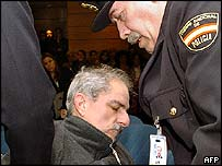 Officers help Adolfo Scilingo in court