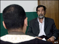 Chief Investigative Judge Raid Juhi questions Saddam Hussein in a photo released by the tribunal and taken on 23 August 2005