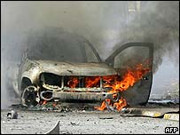 The wreckage of a car destroyed by bombers in Baghdad