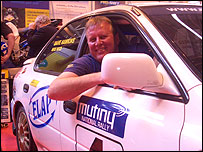 Photo of Dave Hawkins in his rally car