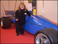 Image of Joy Rainey with her sports racer
