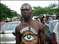 A George Weah supporter with slogans painted on his body (Photo by Jonathan Paye-Layleh)