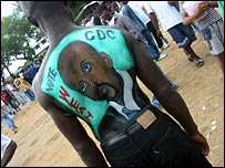 A CDC supporter with George Weah painted on his back (Photo by Jonathan Paye-Layleh)