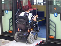 Photo of a wheelchair user getting on a bus