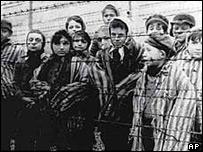 Children behind barbed wire at Auschwitz death camp
