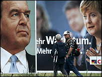 Pedestrians pass election campaign billboards featuring German Chancellor and Social Democrat Gerhard Schroeder (L) and Christian Democrat candidate for chancellor Angela Merkel