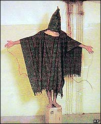A hooded Iraqi prisoner at Abu Ghraib jail (picture courtesy of The New Yorker)