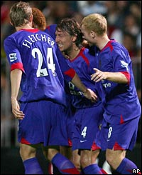 Gabriel Heinze is congratulated by his team-mates