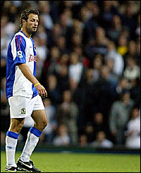 Lucas Neill was sent off for a two-footed challenge on Spurs substitute Edgar Davids