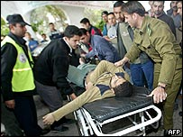 A Palestinian youth is wheeled into hospital following an Israeli incursion into Gaza City
