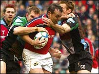 Munster's  Rob Henderson is hit by Gavin Duffy and Dafydd