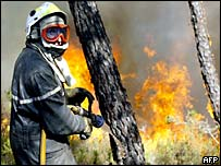 A French firefighter helps fight the flames near Coimbra