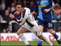 Leon Britton in action against Wycombe