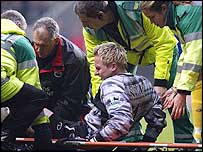 Saints keeper Antti Niemi is stretchered off