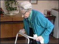 Old lady on zimmer frame