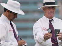 Cricket umpires take a light reading