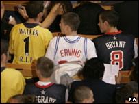 Mourners were asked to wear football or basketball shirts