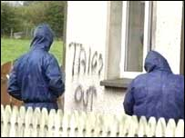 "Graffiti daubed on the wall of the house read: ""Taigs out"""