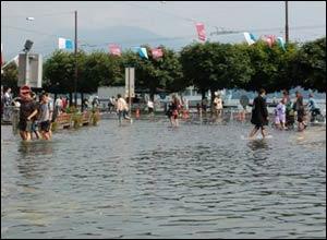 People wade through river water