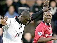 Fulham's Papa Bouba Diop (left) tries to get past West Brom's Kevin Campbell
