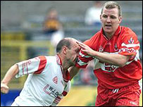 Derry's Johnny McBride (right) in action against Tyrone