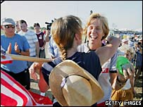 An anti-war protester hugs Cindy Sheehan as she returns to a camp near US President George W. Bush's ranch