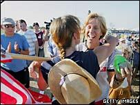 An anti-war protester hugs Cindy Sheehan as she returns to a camp near US President George W. Bush's ranch