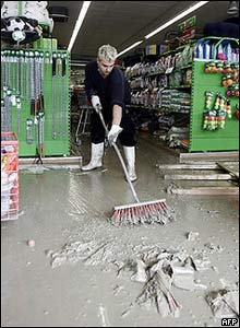In the Austrian city of Woergl a man cleans up in a supermarket after floodwaters receded