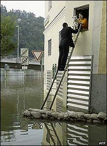 A man on a ladder in the flooded German  city of Passau