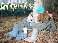 Protesters against the Newbury bypass locked to tree in 1996