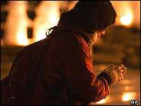 A woman sits to offer a prayer, Sunday Jan. 16. 2005.
