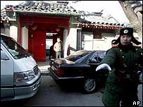 A Chinese paramilitary officer attempts to stop a photographer outside Zhao Zhiyang's house, 17 January 2005
