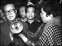 Zhao Ziyang (L) addresses the student hunger strikers through a megaphone at dawn 19 May 1989, with Wen Jiabao (C) by his side