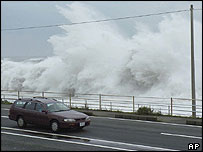 High waves approaching the coastal road in Shizuoka, central Japan