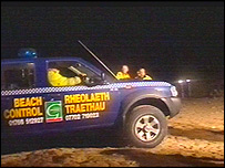 Rescuers on the beach