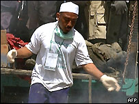 Member of the hard-line Muslim group FPI, after helping rescue works for tsunami victims, 13 January 2005.