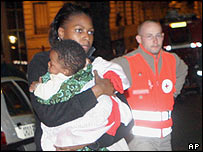 A survivor and her child after a fire in Paris