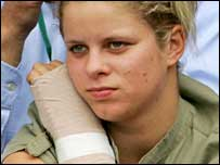 Kim Clijsters nurses her injured wrist