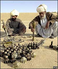 Tribesmen show reporters mortars and shells