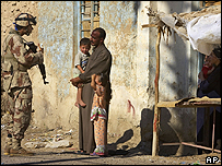 A US soldier speaking to Iraqis in Western Iraq